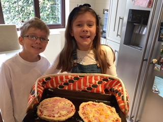 Maisie making pizza with her brother!
