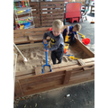 We dig for treasure in the sand pit.