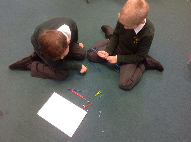 Harry and Danas working to build 3D shapes.