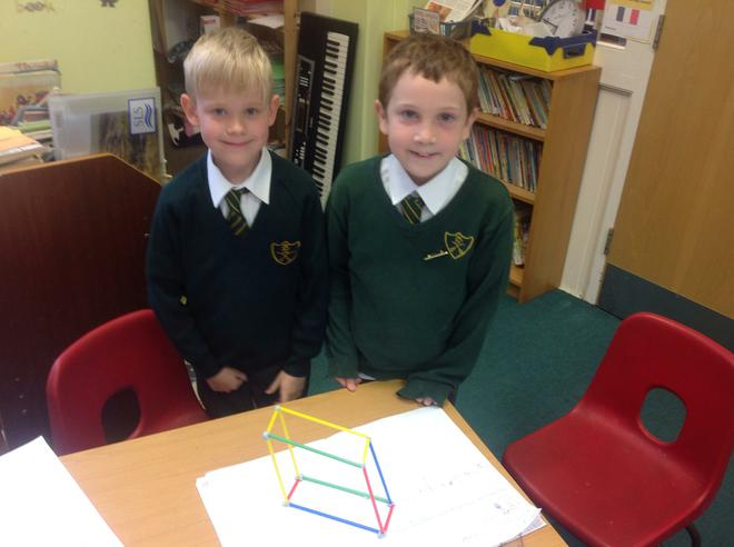 Jake and Rhys using straws to make 3D shapes.