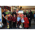 Pupils with the school mascots and professionals