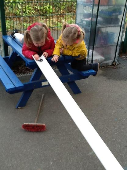 Experimenting, rolling cars down guttering.