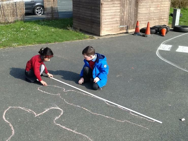 Measuring the length of the shadow.