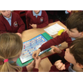 Playing a board game illustrating life as a carer