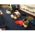 Pupils of 4L completing the CPR process.