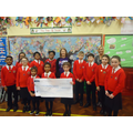 School Council presenting cheque for £450 raised