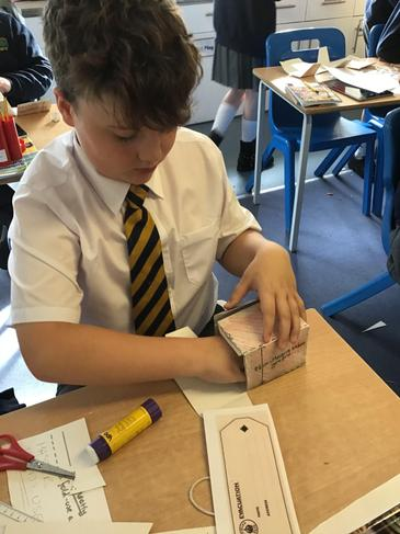 Making boxes to carry our vital gas masks!