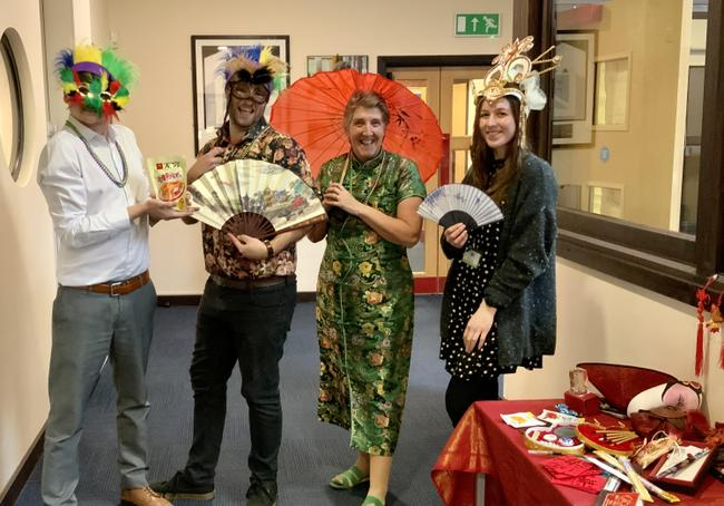 Staff getting in the spirit. Chinese New Year and Mardi Gras