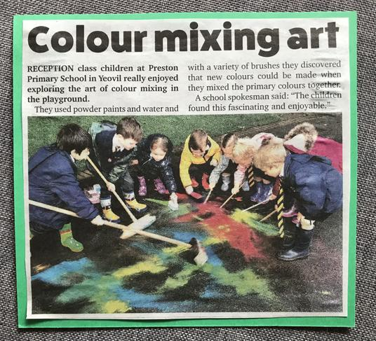 Reception children experimenting with colours on the playground