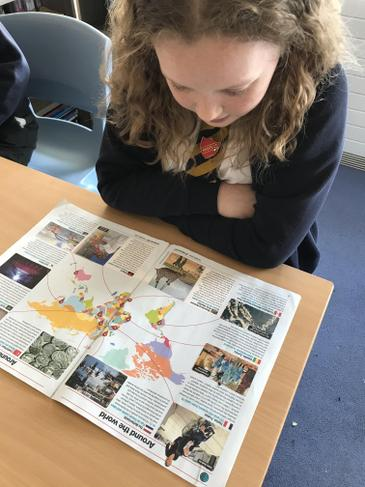 Children enjoy reading the weekly world news events in This Week Junior.