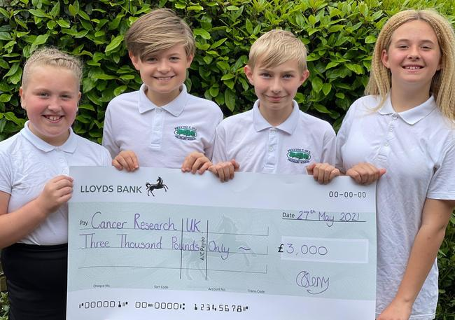 Year 6 raised over £3,000 for Cancer Research via Race for Life. Pict