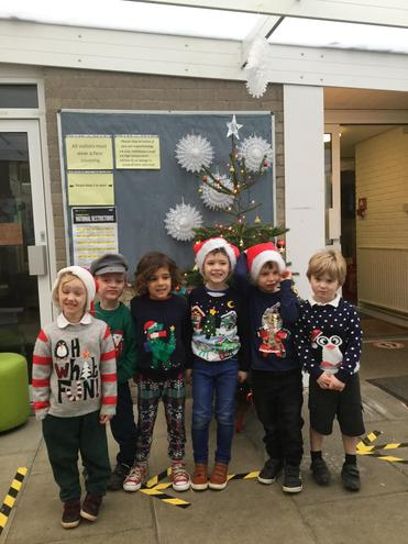 Here we are by the school Christmas tree, looking very festive.