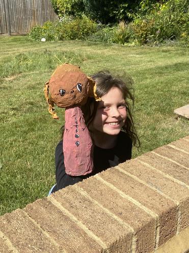 A characterful papier mache puppet