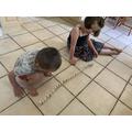 Making dominoes tumble by pushing.