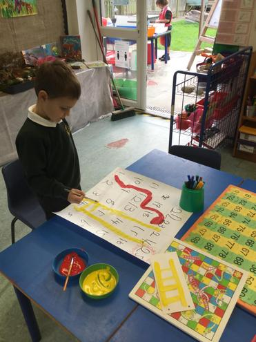 I made a giant snakes and ladder board for the 'Wild things' and us to play.