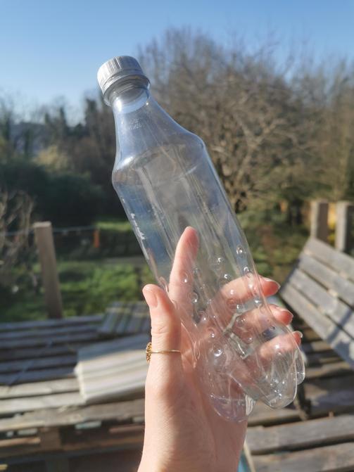 Take an empty clear bottle