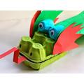 use an egg box to make a dragon