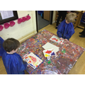 Painting clown faces using cotton buds