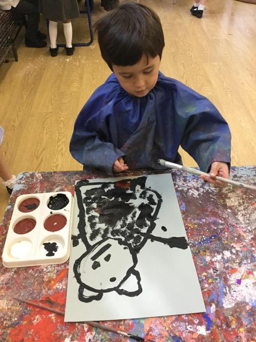 Hamish paints a black bear.