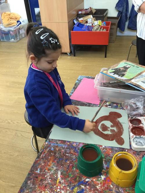 Nikol paints her brown bear.