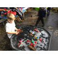 Washing and scrubbing to develop our fine motor skills