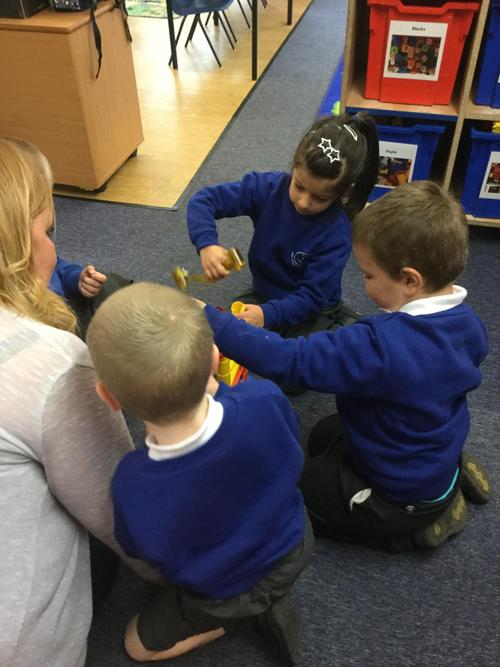 Teamwork with Duplo building towers.