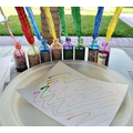 Make a quill to write with by dipping some feathers in different coloured ink
