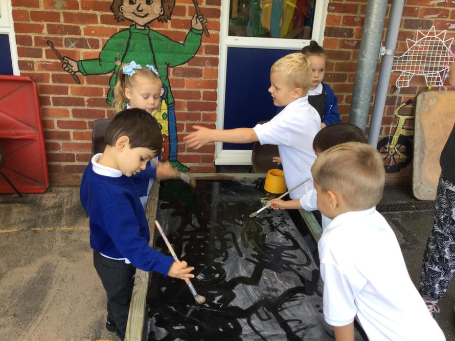 Having a go at mark making with water.