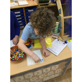 We made shapes on peg boards.