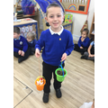 """The orange bucket is heavier so it made the elastic longer."""