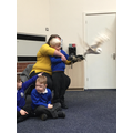 The owls visited and flew around the hall.