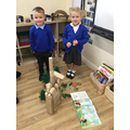 """""""We built a town with lots of places to live and tall houses."""""""
