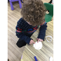 We made Christmas tree decorations from white clay.