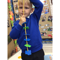 We loved making repeating colour patterns with threading bears.
