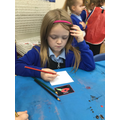 We looked carefully at the photographs and decided how we wanted to create one.