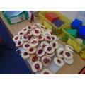 Practising safe chopping skills on fruit.