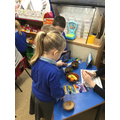 We made fruit sculptures with Plasticine.