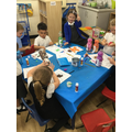 We are completing the blue challenge by collaging a gingerbread man picture.