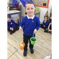 """The orange bucket is heavier so it made the elastic longer."""