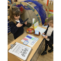 We used Numicom to make numbers and match the correct digit card.