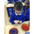 We have been threading beads to make a colour pattern.