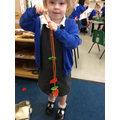 We made repeating colour patterns with threading bears.