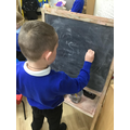 Writing letters with chalks