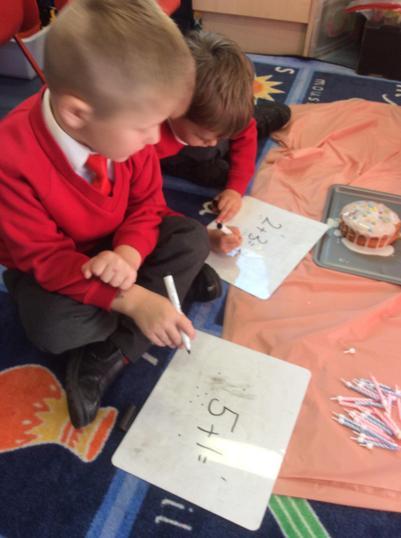 Writing an addition maths story.
