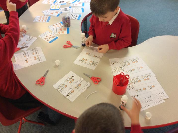 Matching maths stories to animal pictures.