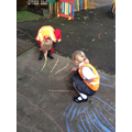 Writing numbers and sounds using the chalk.