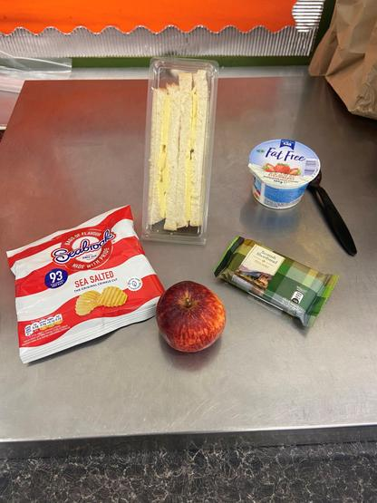 Lunches include: a sandwich (meat or cheese), a snack, yoghurt, fruit & some biscuits.