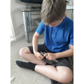 Oliver making his catapult