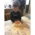 Kneading the pizza dough!
