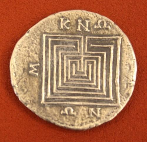 A coin showing a labyrinth